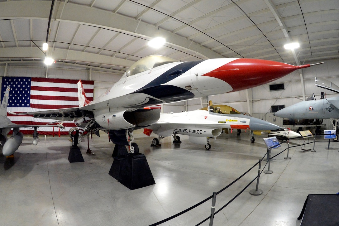 A Thunderbird F-16A Fighting Falcon flown by the U.S. Air Force Thunderbirds aerial demonstration team from 1983-1992 is on display June 1, 2018, at the east end of the Hill Aerospace Museum's Fighter Gallery at Hill Air Force Base, Utah. The aircraft restoration took several months to complete and will be formally unveiled during a private ceremony in conjunction with the Warriors Over the Wasatch Air and Space Show June 23-24 at Hill. (U.S. Air Force photo by Todd Cromar)