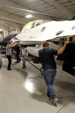 Hill Aerospace Museum staff and volunteers reposition a new additional static display aircraft May 20, 2018, at Hill Air Force Base, Utah. Now located at the east end of the museum's fighter gallery, the former Thunderbird F-16A aircraft will be on display for visitors. (U.S. Air Force photo by Todd Cromar)
