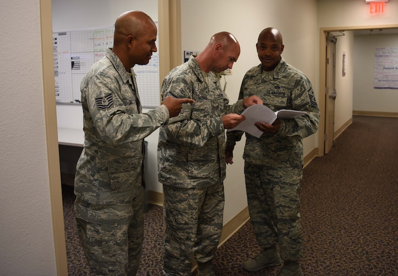 Master Sgt. Thee Thorpe, 90th Medical Group First Sergeant talks to 90th Medical Readiness Flight chief Master Sgt. Jeffery Naughton, and NCO in Charge Tech. Sgt. Josue Diaz June 6, 2018, in the 90th Medical Group Building on F.E. Warren Air Force Base, Wyo. Thorpe schedules time each day to get up and walk around to meet and chat with the people in his group to build trust and confidence between him and his fellow Airmen. Thorpe suggests it will improve leadership skills, personal skills and communication.  (U.S. Air Force photo by Airman 1st Class Braydon Williams)