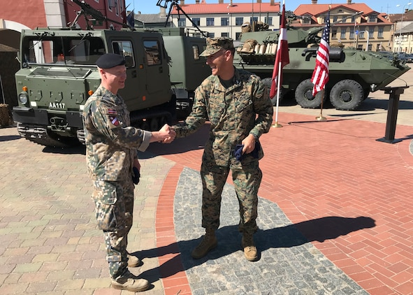 U.S. Marine Corps Col. Peter Lee, head of operations for Marine Forces Europe and Africa thanks Maj. Elmars Popakuls, Commander of Latvian National Guard 53rd Infantry Battalion, during the multinational civil engagement ceremony in Bauska, Latvia June 2, 2018 as part of Exercise Saber Strike 2018. The focus of the ceremony was the integration of multinational forces and the enhancement of the relationships between the U.S. Marines and their Latvian military counterparts. (U.S. Marine Corps Photo by Maj. Greg Wolf/Released)