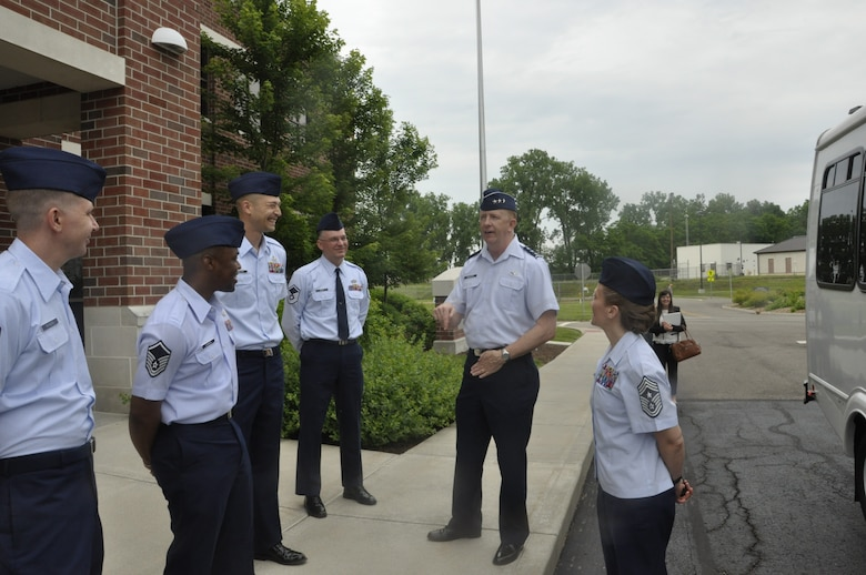 Lt. Gen. Robert McMurry (center) commander of the Air Force Life Cycle Management Center and Chief Master Sgt. Michelle Thorsteinson-Richards (right) AFLCMC command chief, talk with Airmen from the Air Force Metrology and Calibration program. McMurry visited AFMETCAL to meet with employees, tour work sections and hold an All Call. (U.S. Air Force photo / Brian Brackens