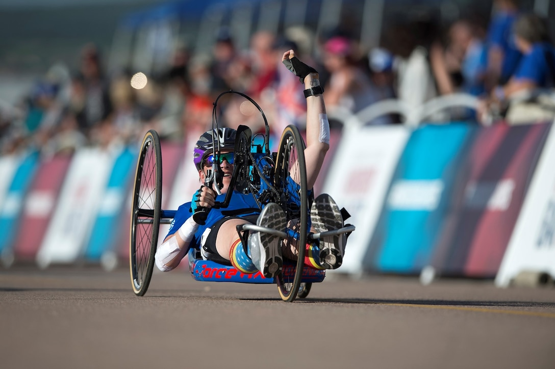 Team Air Force Master Sgt. Lisa Goad reacts to finishing the 2018 Department of Defense Warrior Games cycling competition at the U.S. Air Force Academy in Colorado Springs, Colo., June 6, 2018. DoD photo by EJ Hersom