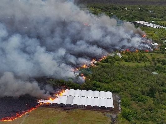 Lava from the Kilauea eruption engulfs a nursery in Kapoho, Hawaii, June 2, 2018. The building was photographed from a UH-60 Black Hawk helicopter during a mission to survey possible landing zones for evacuation of residents in the area.