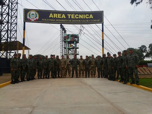 Sgt. 1st Class Héctor Guillén, West Virginia National Guard State Partnership Program coordinator and Peru native, poses with members of the U.S. Army South Non-commissioned officer (NCO) professional development team and Peruvian Army June 1, 2018 in Lima, Peru. Guillén provided training in Spanish on NCO leadership and development to the Peruvian Army.