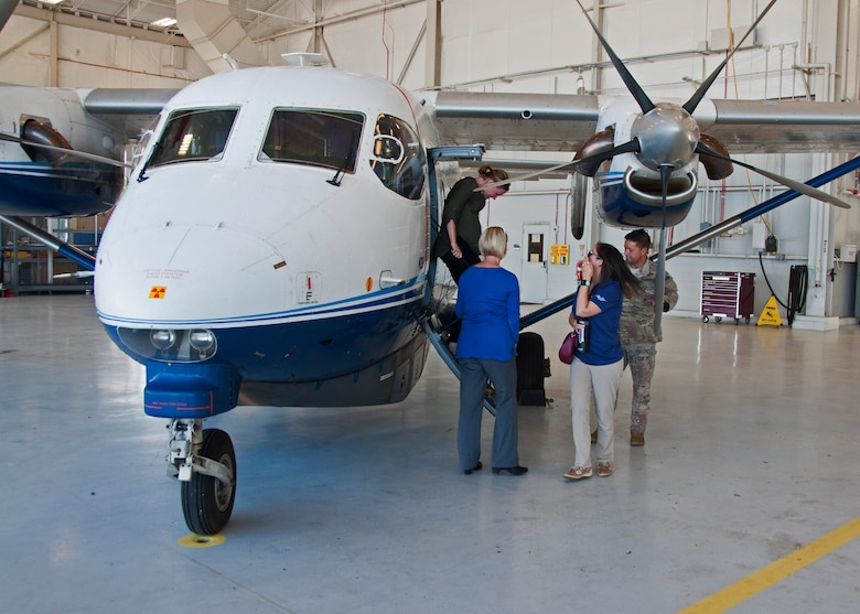 Local employers take turns viewing the interior of a C-145 Skytruck June 4, 2018 at Duke Field, Fla.