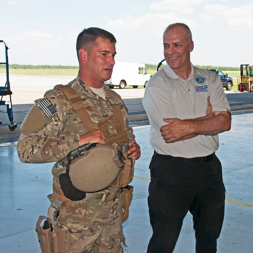 Staff Sgt. Dan Ordoqui, 919th Special Operations Security Forces Squadron, gives a unit mission overview to James Dicks,