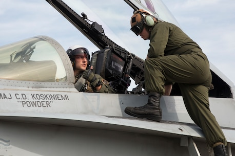 Lance Cpl. Hunter Cathron, right, speaks with Maj. Kevin Bowler prior to take off aboard Marine Corps Air Station Beaufort June 6. Cauthron is the plane captain for this particular aircraft and prior to every flight, he signs off on the inspection, certifying that the pilot is flying an aircraft that is mission ready. At just 23 years old, Cauthron holds the responsibility of ensuring the safety of every Marine on the flight deck before, during and after flight operations and missions. Cauthron is an engine mechanic and plane captain with Marine Fighter Attack Squadron 312.
