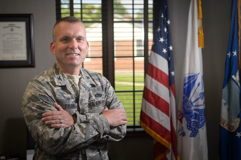 U.S. Air Force Col. Sean Tyler, 633rd Air Base Wing commander, stands in his office at Joint Base Langley, Va., June 6, 2018.