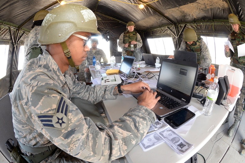"Senior Airman Brandon Peterson, Finance/Contracting Directorate, practices finance work in a ""deployed environment"" during a field exercise May 3, 2018, at Hill Air Force Base, Utah. (U.S. Air Force photo by Todd Cromar)"