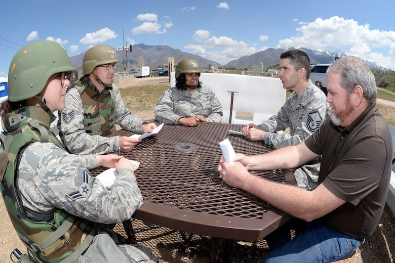 (Left to right) Airman 1st Class Allison West and Staff Sgt. Andrew Dowling, Contracting Directorate, and Master Sgt. Tamika Felder 388th Finance Management, negotiate with Master Sgt. Christopher Castro, Contracting Directorate superintendent, and Marc Mattson, also Contracting Directorate, during a field exercise May 3, 2018, at Hill Air Force Base, Utah. (U.S. Air Force photo by Todd Cromar)