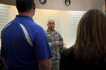 Lt. Col. Brooks Wilkerson speaks to volunteers during an orientation at Air Force Mortuary Affairs Operations.