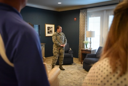 Tech. Sgt. Dorothy Whitfield briefs volunteers during a visit to the Fisher House for Families of the Fallen.