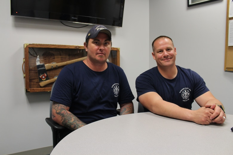 Wright-Patterson Air Force Base firefighters Brian Grubb, left, and Brice Morgan said after spending so much time with each other in the fire house, firefighters build a close bond with each other and know what's going on in each other's lives and are always there to support one other on and off duty. Grubb is also the president of the International Association of Firefighters Local F88 Union of Professional Fire Fighters of Wright-Patterson Air Force Base. (U.S. Air Force photos/Stacey Geiger)