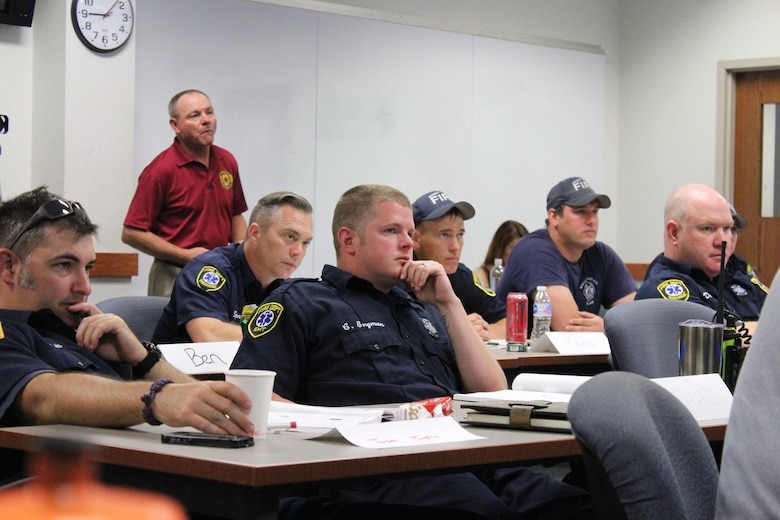 Members of the Wright-Patterson Air Force Base Fire Department attend a Post-Traumatic Stress Disorder/Peer Support program training on June 6. Firefighters participated in a two-day course to learn how to be a peer supporter for their counterparts when that person may not want to talk to the typical outlets such as a chaplain or supervisor. (U.S. Air Force photos/Stacey Geiger)