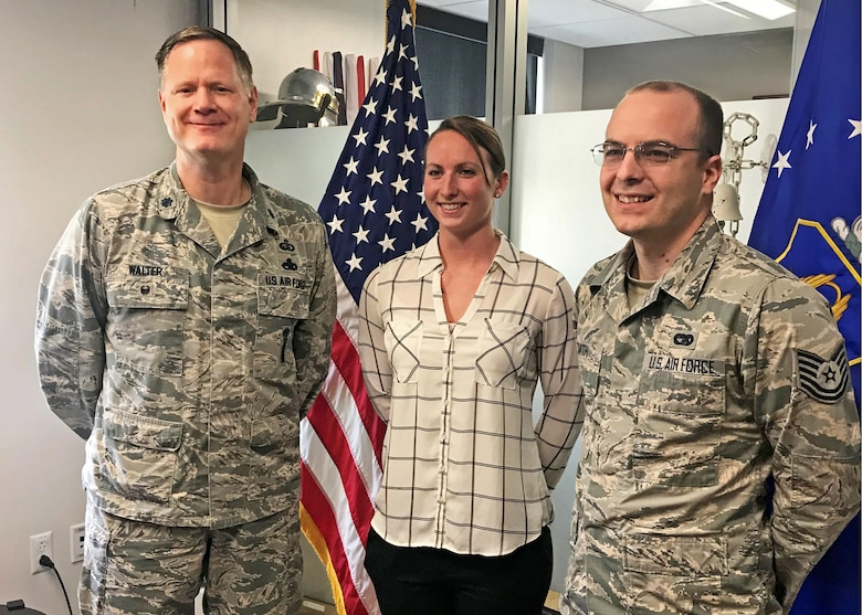 "Lt. Col. Joseph Walter, wing process manager for the 442d Fighter Wing, soon-to-be 2nd Lt. Margaret ""Maggie"" Ann Atkins and Tech. Sgt. Michael Smith, Officer Accessions recruiter at Scott AFB, pose for a photo after Atkins takes the oath of enlistment at Whiteman Air Force Base, May 21, 2018."