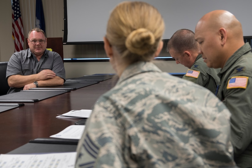 Stan Gohl, 437th Airlift Wing historian, presents the idea of placing stone beneath the heritage aircraft at the air park here during the Squadron Innovation Fund panel meeting June 4, 2018.