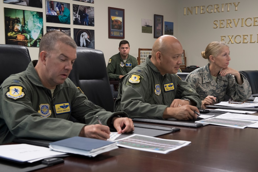 Col. Patrick Winstead, left, 437th Airlift Wing vice commander, and Col. Jimmy Canlas, middle, 437th Airlift Wing commander, and Chief Master Sgt. Jennifer Kersey, right, 437th AW command chief, listen to a pitch during the Squadron Innovation Fund panel meeting June 4, 2018.