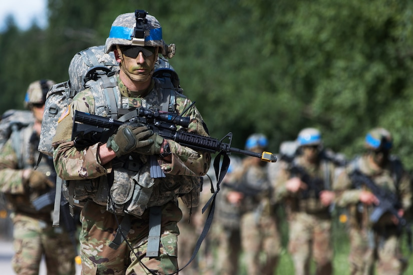 Soldiers conduct a ruck march during Saber Strike 18 at the Pabrade Training Area, Lithuania.