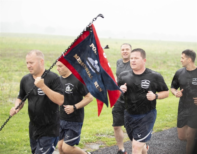 """Approximately 20 service members, both active duty and retired, from Air Mobility Command, the 618th Air Operations Center and the 375th Logistics Readiness Squadron completed the annual """"Port Dawg Memorial Run"""" at the end of National Transportation Week."""