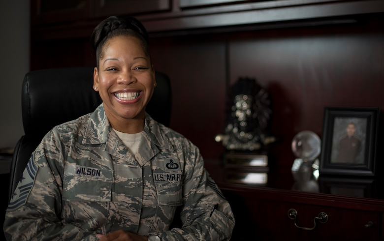 "U.S. Air Force Chief Master Sgt. Yasmeen Wilson, 33rd Fighter Wing command chief, sits in her office May 9, 2018, at Eglin Air Force Base, Fla.  Wilson created a motivational group for women called W.I.N.G.S., ""Women Inspiring the Next Generation's Successes,"" which focuses on personal and professional development, strengthens interpersonal communication skills, heightens self-awareness and encourages self-confidence. (U.S. Air Force photo by Airman 1st Class Daniella Peña-Pavao)"