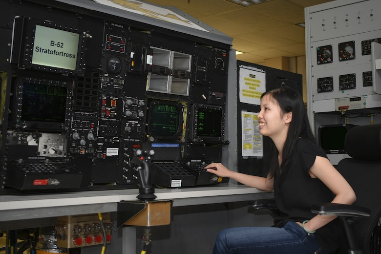 B-52H Mission Planning Environment Team Electronics Engineer Nhi Dinh works on Tinker Air Force Base's B-52 simulator designed to test the B-52H MPE team's new coding and upgrades to the U.S. Air Force's B-52 fleet of bombers.