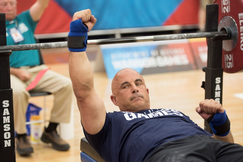 Navy Reserve Senior Chief Petty Officer Joe Paterniti cheers for Team Navy after competing in powerlifting during the 2018 Department of Defense Warrior Games at the U.S. Air Force Academy in Colorado Springs, Colo.