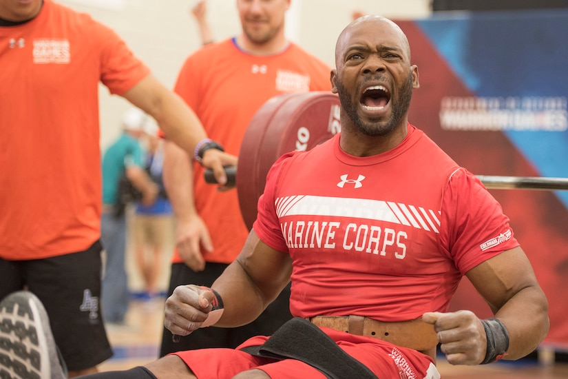 Marine Corps Master Gunnery Sgt. Carnell Martin competes in powerlifting during the 2018 DoD Warrior Games at the U.S. Air Force Academy in Colorado Springs, Colo.