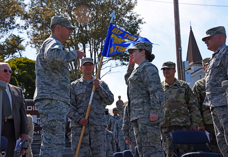 U.S. Air Force Col. Wiley Barnes, 517th Training Group commander, salutes Lt. Col. Jaclyn DeRoush's 314th Training Squadron incoming commander, during the 314th TRS Change of Command at the Presidio of Monterey, California, June 6, 2018. As the 314th TRS commander DeRoush is responsible for training and developing linguists for the United States Air Force and her sister services. (U.S. Army photo by Natela Cutter/Released)