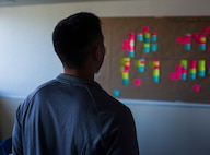U.S. Air Force 2nd Lt. Andre Andrada, the 35th Maintenance Squadron maintenance flight commander, reviews sticky notes hung on a board during the Continuous Process Improvement program at Misawa Air Base, Japan, May 22, 2018. The CPI program gives personnel the tools to analyze processes within their respective units to ensure methods and procedures are optimized.