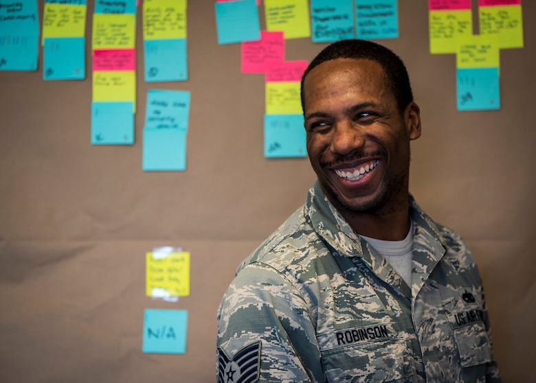 U.S. Air Force Tech. Sgt. Teko Robinson, the 35th Maintenance Squadron crash damage and disabled aircraft recovery team chief, smiles during the Continuous Process Improvement program at Misawa Air Base, Japan, May 22, 2018. The CPI program is one example of how the Air Force is supporting innovation and reducing redundant practices by educating Airmen on how they can improve their units.