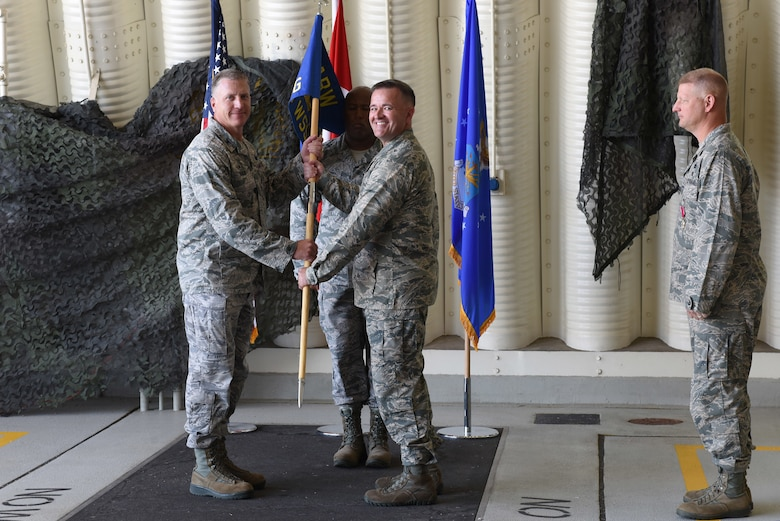 U.S. Air Force Col. David Eaglin, 39th Air Base Wing commander, presents the guidon to Col. Paul Quigley, 39th Weapons System Security Group commander, during the 39th WSSG change of command ceremony at Incirlik Air Base, Turkey, June 7, 2018.