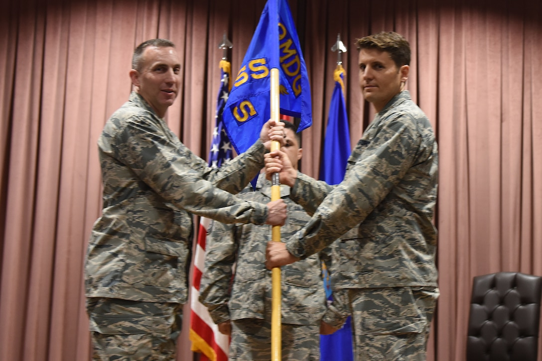 "U.S. Air Force Col. Christopher Estridge, 39th Medical Group commander, presents the guidon to Lt. Col. Thomas ""Jason"" Telfer, 39th Medical Support Squadron commander, during a change of command ceremony at Incirlik Air Base, Turkey, June 8, 2018."