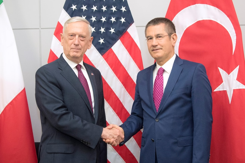 Defense Secretary James N. Mattis shakes hands with the Turkish defense minister.