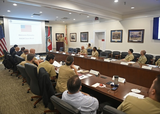 U.S. and Peruvian Naval leaders meet around a table.