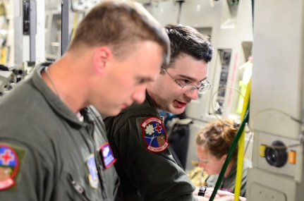 An Air Force medical team helps loading critically injured patients onto an aircraft.
