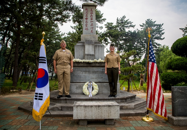 U.S. Navy Capt. Denis Cox (left) and U.S. Marine Col. Maria McMillen (right) in front of the 1st Marine Aircraft Memorial Monument during a memorial ceremony at Pohang City Battle Monument and 1st MAW Memorial Monument in Pohang, South Korea, June 6, 2018. The Korea Freedom Federation Songdo Branch hosted the ceremony to remember the fallen service members who gave the ultimate sacrifice in the Korean War. Cox, a native of Columbus, Ohio, is 1st MAW's wing chaplain. McMillen, a Craig, Colorado native, is the G-5 assistance chief of staff with 1st MAW.