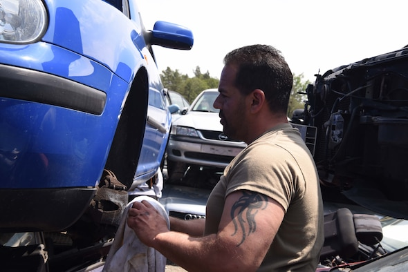 Brian Davidson searches for car parts at the 86th Force Support Squadron Auto Recycling Center near Ramstein Air Base, Germany, May 17, 2018. The Auto Recycling Center offers services for military members and their dependents looking to repair, get rid of, or purchase a car.