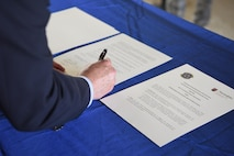 Ingolf Hubert, Polizei head of department of education and training, signs a memorandum of agreement with the 569th U.S. Forces Police Squadron on Kapaun Air Station, June, 6, 2018. The MOA also ensures professionalism and competence between U.S. forces and host nation law enforcement organizations.
