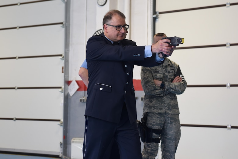 Ingolf Hubert, Polizei head of department of education and training, shoots a new stun gun that the 569th U.S. Forces Police Squadron use to train their officers on Kapaun Air Station, Germany, June 6, 2018. The partnership between the U.S. forces and Polizei is built on a solid foundation of respect and rules.