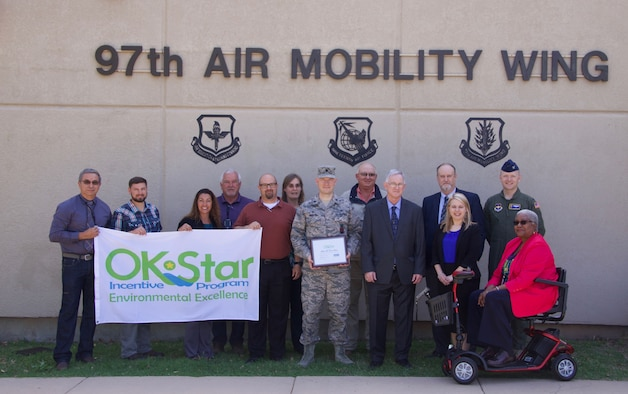 The 97th Civil Engineer Environmental Management Flight receives the Oklahoma Star, Platinum Star, award by the Oklahoma Department of Environmental Quality, joined by U.S. Air Force Col. Paul Skipworth, a vice commander assigned to the 97th Air Mobility Wing, and Col. Paul Frantz, a squadron commander assigned to the 97th CES, May 2, 2018, at Altus Air Force Base, Okla.