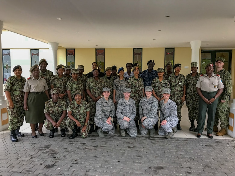 114th Fighter Wing Airmen pose with members of the Suriname Defense Force during the National Guard State Partnership Program's Women in the Military Conference May 14-19, 2018.
