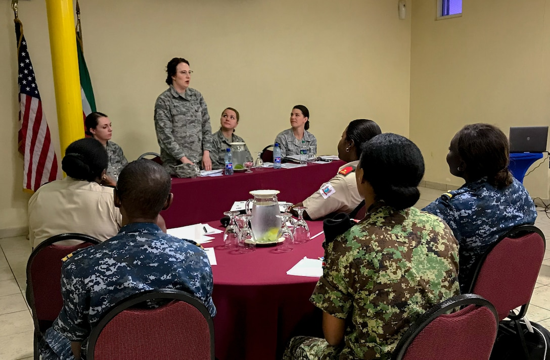 Tech. Sgt. Rachael Bjerke, 114th Medical Group dental assistant, talks about her experience in the South Dakota Air National Guard to Suriname Defense Force members during the National Guard State Partnership Program's Women in the Military Conference May 14-19, 2018.