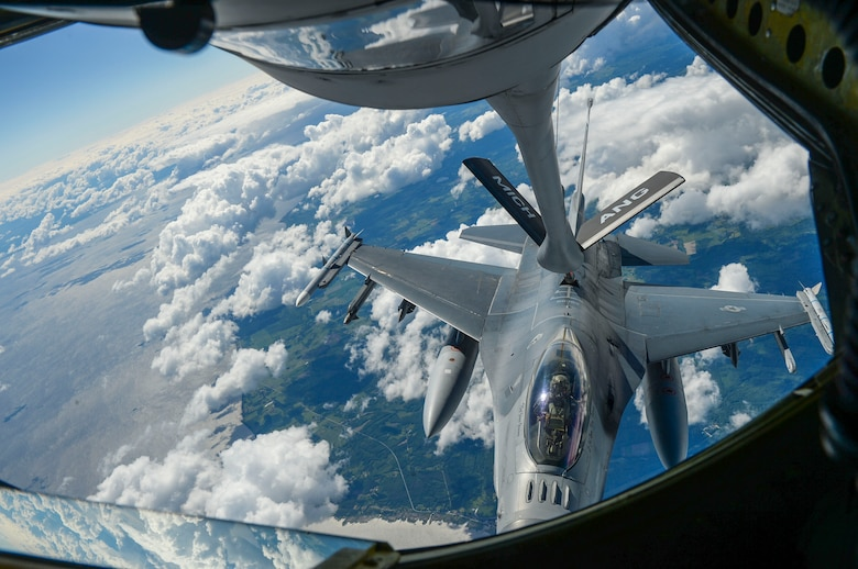 A U.S. Air Force F-16 Fighting Falcon deployed to U.S. Air Forces in Europe from the 120th Fighter Squadron at Buckley Air Force Base, Colorado receives fuel in flight by a KC-135 Stratotanker over Latvia during Saber Strike 18 June 6, 2018. The KC-135 aircraft provides aerial refueling capabilities for the U.S. and its partners allowing an enhanced projection of airpower. (U.S. Air Force photo by Staff Sgt. Jimmie D. Pike)