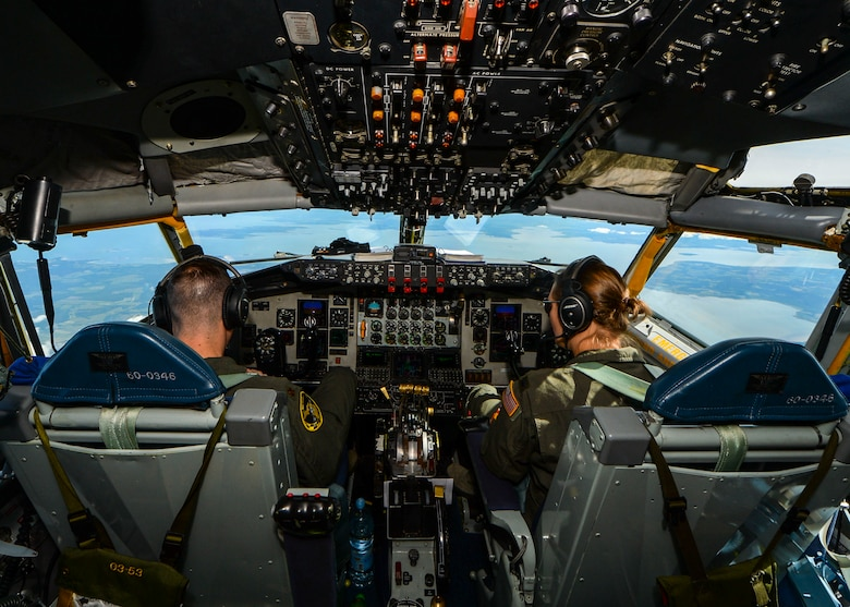 U.S. Air Force Maj. Luke Luikens and 1st Lt. Jennifer Logsdon, 171st Air Refueling Squadron KC-135 Stratotanker pilots, fly a KC-135 for a refueling mission during Saber Strike 18, June 8, 2018. During Saber Strike, KC-135s were used to refuel other aircraft such as the A-10 Thunderbolt II and the F-16 Fighting Falcon, to prolong their flight time for extended training scenarios. (U.S. Air Force photo by Staff Sgt. Jimmie D. Pike)