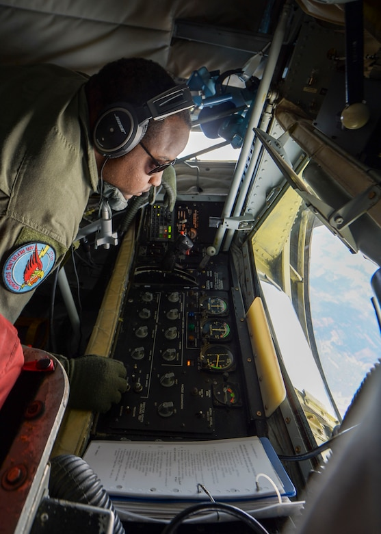 U.S. Air Force Senior Airman Andre McClain, 171st Air Refueling Squadron boom operator, prepares a KC-135 Stratotanker's boom to refuel aircraft during Saber Strike 18 June 8, 2018. Boom operators are responsible for being the pilots' eyes at the back of the aircraft as well as operating the boom during refueling missions. (U.S. Air Force photo by Staff Sgt. Jimmie D. Pike)