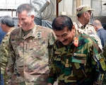 Army Gen. John W. Nicholson, commander of NATO's Resolute Support mission and of U.S. Forces in Afghanistan, shares a laugh with Afghan National Army Gen. Imam Nazar.