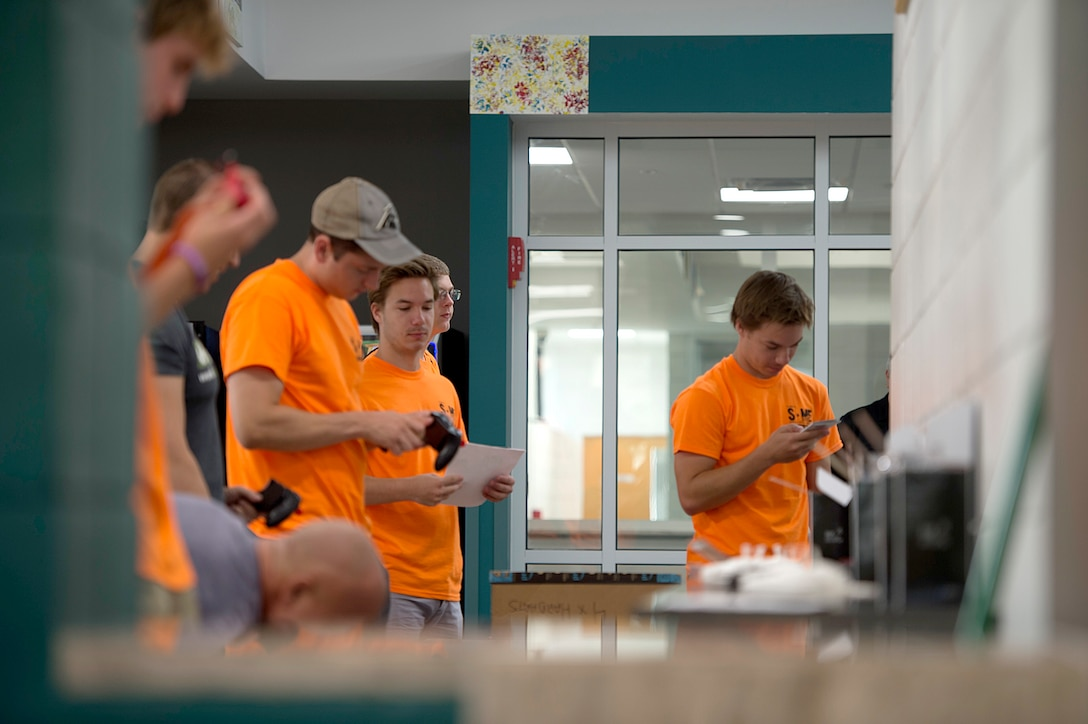 Children at the youth center set up drones at MacDill Air Force Base, Fla., during a Science Technology Engineering and Math camp June 5, 2018.
