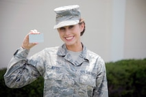 U.S. Air Force Airman 1st Class Brookylnn Woods, a customer service apprentice assigned to the 6th Force Support Squadron (FSS), pauses for a photo with the new, unprocessed common access card (CAC) at MacDill Air Force Base, Fla., June 5, 2018.