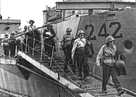 U.S. Army Air Forces nurses make their way down the ramp of their Landing Craft Infantry amphibious assault ship on the Mediterranean island of Pantelleria, Italy in 1943. The 34th Station Hospital on the island became the first Army Air Forces hospital truly attached to an Army Air Forces unit. (National Archives)