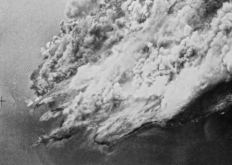 Billowing smoke covers bomb-blasted Mediterranean island of Pantelleria, Italy, where the Allies dropped 6,202 tons of bombs for more than a month in 1943. (National Archives)